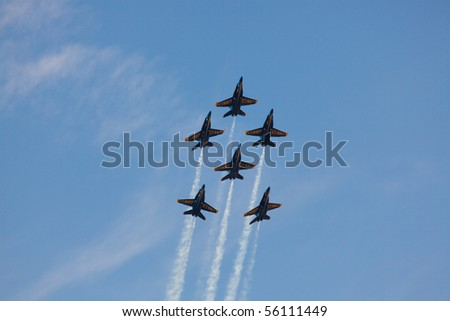 WASHINGTON DC, ANDREWS AFB, MAY 15: US Navy Demonstration Squadron Blue angels, flying on Boeing F/A-18 showing precision of flying and the highest level of pilot skills. Washington DC, May 15, 2010 - stock photo