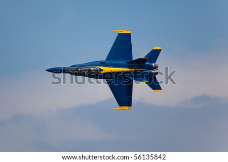 WASHINGTON DC, ANDREWS AFB- MAY 15: US Navy Demonstration Squadron Blue angels, flying on Boeing F/A-18 showing precision of flying and the highest level of pilot skills. Washington DC, May 15, 2010 - stock photo