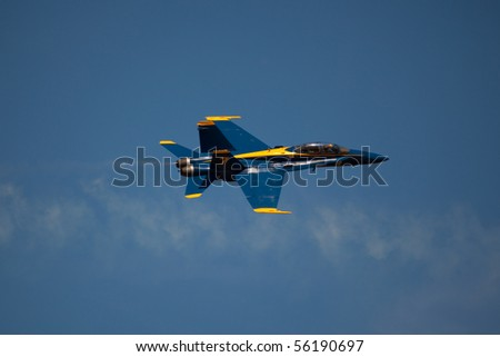 WASHINGTON DC, ANDREWS AFB-MAY 15: US Navy Demonstration Squadron Blue angels, flying on Boeing F/A-18 showing precision of flying and the highest level of pilot skills May 15, 2010 in Washington DC. - stock photo