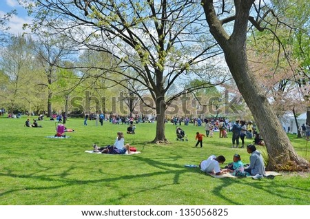 WASHINGTON, DC - APRIL 13: Cherry Blossom Festival on April 13, 2013 in Washington DC,USA. The festival is a spring celebration in Washington, D.C.and people from all over the world come to visit. - stock photo