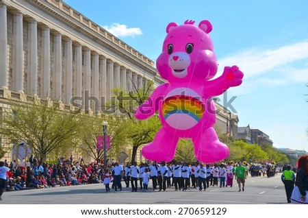 WASHINGTON, DC - APRIL 11: Cherry Blossom Parade on April 11, 2015 in Washington DC,USA.The parade is a spring celebration in Washington D.C.and people from all over the world come to watch the event - stock photo