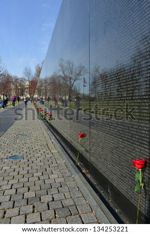 WASHINGTON DC -APRIL 1: Names on Vietnam War Veterans Memorial on April 1st, 2013 in Washington DC, USA. The memorial receives around 3 million visitors each year - stock photo