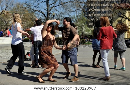 Washington, DC - April 12, 2014:  People doing Salsa dancing in the open plaza at Dupont Circle on a warm Spring afternoon