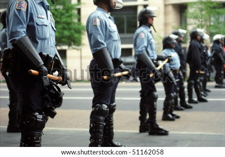 WASHINGTON, DC - APRIL 16: Riot police are positioned to confront protesters during World Bank and IMF meetings on April 16, 2000 in Washington, D.C. - stock photo