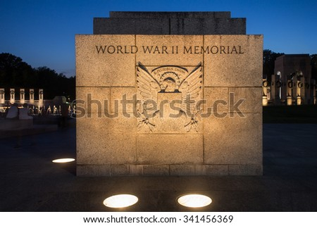 WASHINGTON DC, - AUGUST 8, 2015:  Night view of memorial stone at the World War II Memorial at the National Mall in Washington DC.  - stock photo