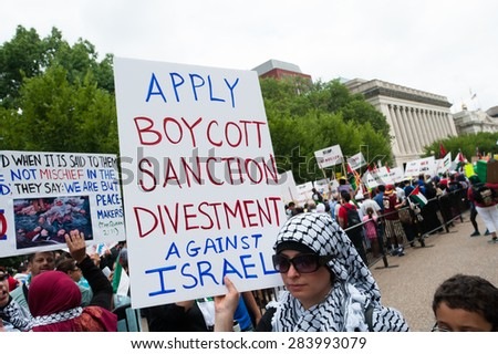 "WASHINGTON, DC - AUGUST 2: Some 10,000 demonstrators march on the White House in Washington, DC, to protest Israel's offensive in Gaza known as ""Operation Protective Edge"", August 2, 2014.  - stock photo"