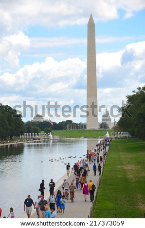 WASHINGTON, DC - AUGUST 17: Washington DC Monument and Capitol on August 17, 2014 in Washington DC,USA. Famous Washington DC Monument in Washington, D.C, people from all over the world come to visit. - stock photo