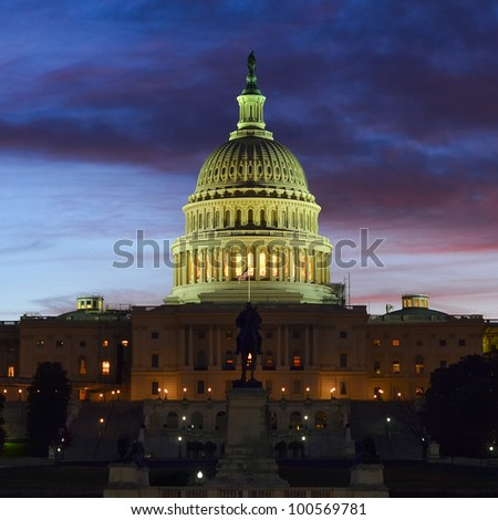 Washington DC, Capitol Building in a cloudy sunrise with mirror reflection - stock photo
