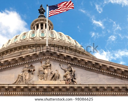 Washington DC Capitol dome closeup with American flag flying - stock photo