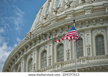 Washington DC Capitol dome detail with waving american flag