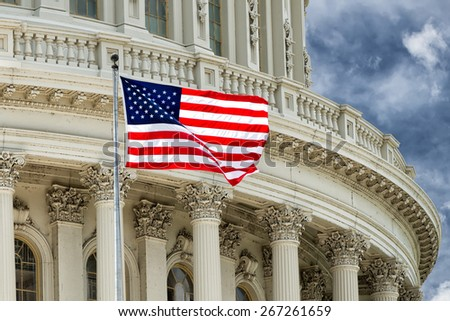 Washington DC Capitol dome detail with waving american flag - stock photo