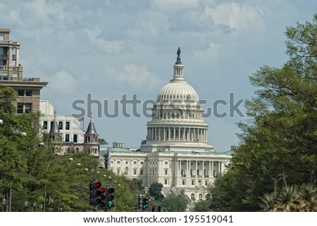 Washington DC Capitol view from Freedom Plaza on cloudy sky - stock photo