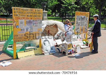 WASHINGTON DC - CIRCA JULY 2009: Protesting woman against nuclear weapon in front of White house circa July 2009 in Washington DC, USA. - stock photo