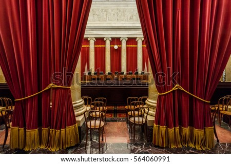 WASHINGTON DC - CIRCA MARCH 2015: The interior of the United States Supreme Court has nine chairs for nine justices. The court is located in Washington DC.