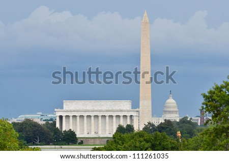 Washington DC city view in a cloudy summer day, including Lincoln Memorial, Monument and Capitol building - stock photo