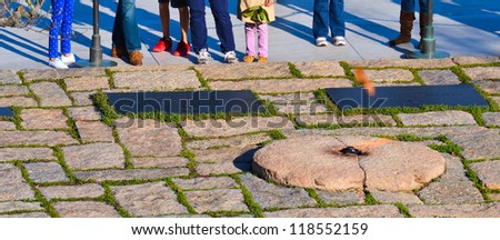 Washington DC,  Eternal flame at President John F. Kennedy Gravestone in Arlington National Cemetery - stock photo