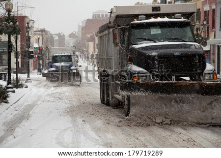 WASHINGTON, DC - FEBRUARY 3: Winter storm of the Mid Atlantic on February 3, 2014 in Washington, DC. Trucks plowing Wisconsin Ave. in Georgetown. The government, stores and companies where closed. - stock photo