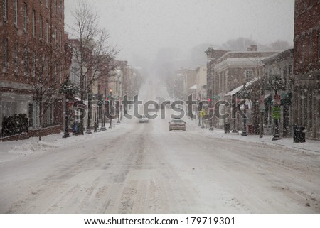 WASHINGTON, DC - FEBRUARY 3: Winter storm of the Mid Atlantic on February 3, 2014 in Washington, DC. M street in downtown Georgetown. The government as well as most stores and companies where closed. - stock photo
