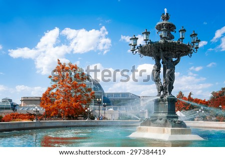 Washington DC historical Bartholdi Fountain and United States Botanic Garden Conservatory. Focus on the fountain in the foreground. - stock photo