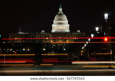 Washington DC in the night - US Capitol Building with car lights trails foreground  - stock photo