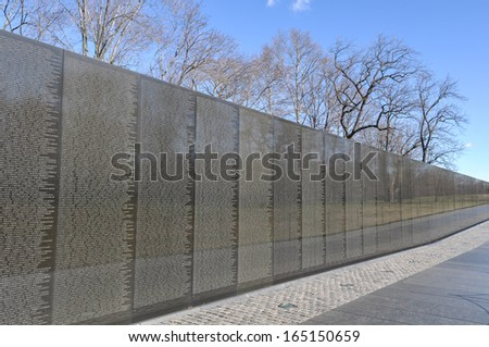 WASHINGTON DC -JANUARY 18: Names on Vietnam War Veterans Memorial on July 18, 2010 in Washington DC, USA. The memorial receives around 3 million visitors each year. - stock photo