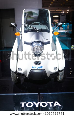 Washington, DC - January 28, 2018: Toyota displays its futuristic i-Road vehicle to potential customers. The concept car has an electric drive-train and can be charged with a household power outlet.
