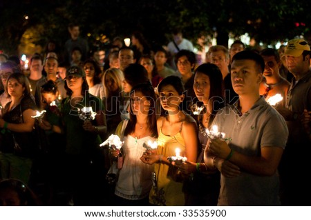 WASHINGTON, DC - JULY 9: A candle light vigil honors Iranians killed in election protests, and marks the 10th anniversary of the Tehran student uprising known as 18 Tir on July 9, 2009. - stock photo