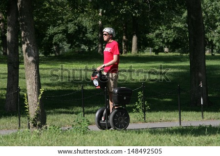 WASHINGTON, DC - JULY 29: A tour guide operates a Segway during a Segway tour along the National Mall on July 29, 2013 in Washington.  - stock photo