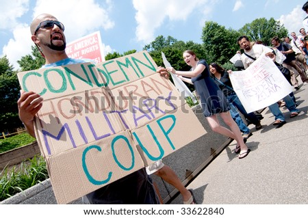 WASHINGTON, DC - JULY 1, 2009: Activists march at the U.S. State Department to protest the military coup against Honduran President Manuel Zalaya on July 1, 2009. - stock photo