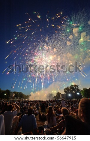 WASHINGTON DC - JULY 4:  Fireworks shows captivate the crowd in celebration of America's birthday at the National Mall on July 4, 2010 in Washington, DC. - stock photo