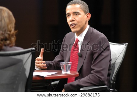 WASHINGTON, DC - JUNE 4, 2007: Barack Obama is interviewed by Soledad O'Brien during the Sojourners and CNN presidential candidates forum on faith, values, and poverty. - stock photo