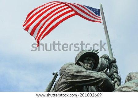 WASHINGTON, DC - JUNE 25, 2014: Iwo Jima Memorial in Washington, DC. The Memorial honors the Marines who have died defending the US since 1775 and a prominent tourist attraction in Washington DC.  - stock photo