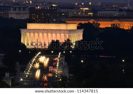 Washington DC, Lincoln Memorial and car traffic on Arlington Memorial Bridge at night - stock photo