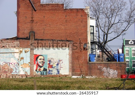 WASHINGTON, DC, MARCH 7 : Shepard Fairey inspired Obama poster remains posted months after the historic election in Washington, DC on March 7, 2009. - stock photo