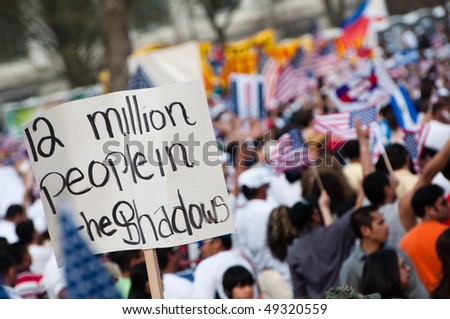 WASHINGTON, DC - MARCH 21: Some 200,000 immigrants' rights activists flood the National Mall to demand comprehensive immigration reform on March 21, 2010 in Washington DC. - stock photo
