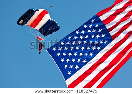 WASHINGTON DC - MAY 8:A skydiver Paul McCowan with US flag parachuting at the Joint Services Open House airshow on May 8,2012. It is the second largest known flyable American flag in existence.