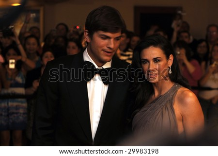 WASHINGTON, DC - MAY 9: Demi Moore and Ashton Kutcher arrive at the White House Correspondents' Dinner May 9, 2009 in Washington, D.C. - stock photo
