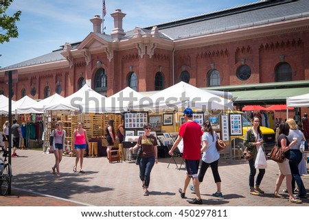 WASHINGTON DC-May 24, 2015: Historic Eastern Market in the Capitol Hill area, first opened in 1805. The indoor food market and outdoor artisan stalls attract a diverse crowd of visitors and locals. - stock photo
