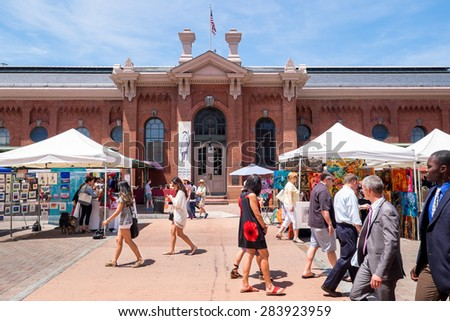 WASHINGTON DC-May 24, 2015: Historic Eastern Market in the Capitol Hill neighborhood, first opened in 1805. The indoor food market and outdoor artisan stalls attract both visitors and residents. - stock photo