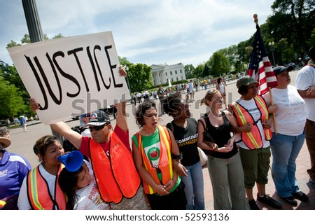 WASHINGTON, DC - MAY 1: Immigration reform activists protest at the White House on May 1, 2010 in Washington, DC. - stock photo