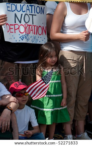 WASHINGTON, DC - MAY 1: Immigration reform activists protest on May 1, 2010 at the White House in Washington, DC. - stock photo
