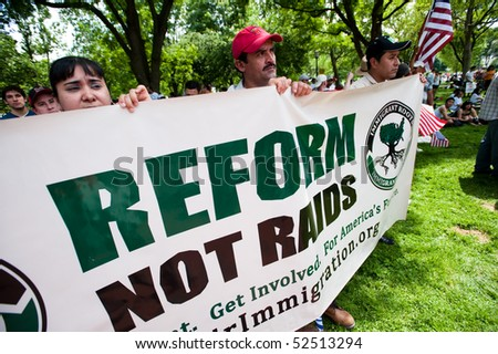 WASHINGTON, DC - MAY 1: Immigration reform activists protest on May 1, 2010 at the White House on in Washington, DC. - stock photo