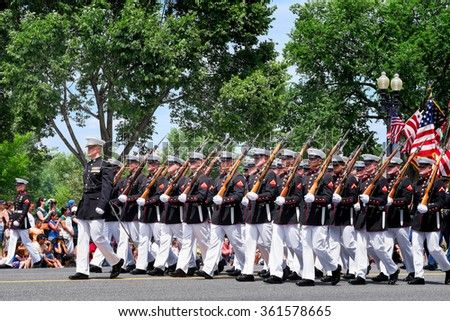 WASHINGTON DC-May 25, 2015: Memorial Day Parade. A marching platoon from the United States Marine Corps wearing blue-white dress uniforms.  - stock photo