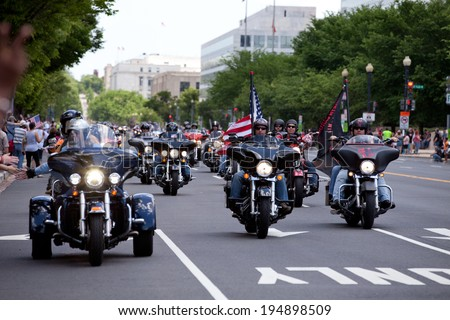 WASHINGTON, DC - MAY 25: Motorcycles travel in DC as part of the annual Rolling Thunder motorcycle Ride for Freedom� for American POWs and MIA soldiers on May 25, 2014 in Washington, DC. - stock photo