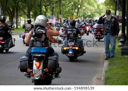WASHINGTON, DC - MAY 25: Motorcycles travel in DC as part of the annual Rolling Thunder motorcycle Ride for Freedom for American POWs and MIA soldiers on May 25, 2014 in Washington, DC. - stock photo