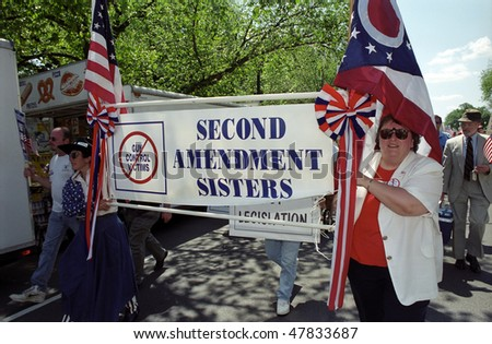 WASHINGTON, DC - MAY 14: Pro-gun activists march as counter-protesters to the Million Mom March, a major rally for gun safety advocates on the National Mall on May 14, 2000 in Washington, DC - stock photo