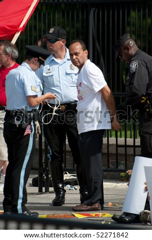 WASHINGTON, DC - MAY 1: Rep. Luis Gutierrez (D-IL) is arrested with immigration reform activists for blocking the sidewalk on May 1, 2010  at the White House in Washington, DC. - stock photo