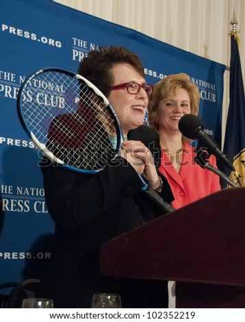 WASHINGTON, DC-MAY 9: Retired professional tennis star Billie Jean King hugs her racquet during her speech to a luncheon at the National Press Club, May 9, 2012 in Washington, DC - stock photo