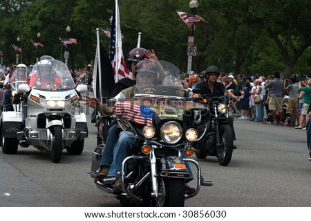 "WASHINGTON, DC - MAY 24 : Riders get ready to ride at memorial weekend the annual Rolling Thunder rally ""Ride For Freedom"" around the Mall May 24, 2009 in Washington, DC. - stock photo"