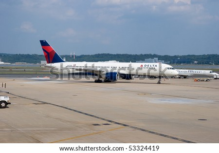 WASHINGTON, DC - MAY 5: U.S. regulators are demanding that Delta Airlines auction off slots at Reagan Airport, to create openings for other airlines. A Delta aircraft on May 5, 2010 in Washington, DC. - stock photo
